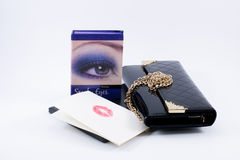 Composition make up accessories, paper with lipstick and a bag Royalty Free Stock Image