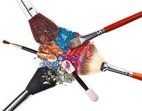 Composition with makeup brushes and broken eye shadow Stock Images