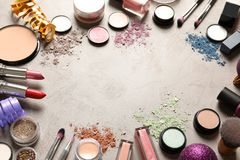 Composition with makeup products and Christmas decor on table royalty free stock image