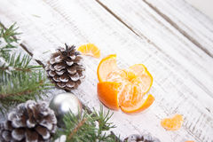 Composition with mandarins and Christmas tree on white rustic wo Royalty Free Stock Photography