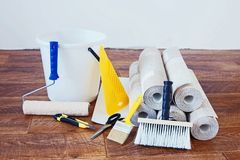 Composition with many rolls of wallpaper and various tools for home repair Royalty Free Stock Images