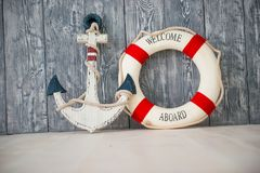 Composition on the marine theme with anchor and lifeline on wooden background.  Royalty Free Stock Photos