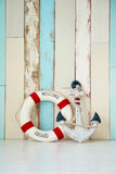 Composition on the marine theme with anchor and lifeline on wooden background.  Stock Image