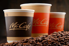 Composition with McCafe coffee cup and beans Stock Photography
