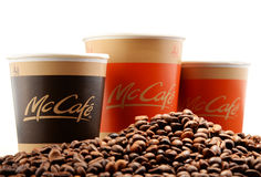 Composition with McCafe coffee cup and beans Stock Photos