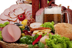 A composition of meat and vegetables with beer Stock Image