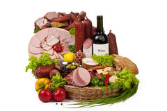 A composition of meat and vegetables with wine. A composition of meat and vegetables with a bottle of wine isolated on white. File includes clipping path for Royalty Free Stock Photography