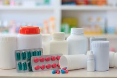 Composition of medicine bottles and pills with pharmacy store Stock Photos