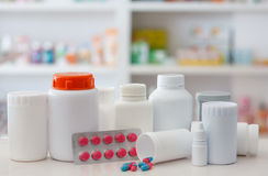 Composition of medicine bottles and pills with pharmacy store sh Stock Image