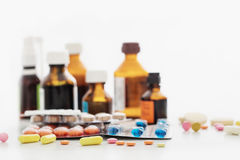Composition of medicine bottles and pills  on white background Royalty Free Stock Photo