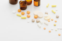 Composition of medicine bottles and pills  on white background Stock Photography