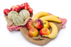 Composition of melons, nectarines, apples and bananas Royalty Free Stock Photos