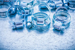 Composition of metal spiral hose clamps on Stock Image