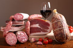 Italian salami on wooden table Royalty Free Stock Image