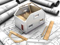 Composition of the mockup of house and blueprints Royalty Free Stock Photo