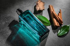 Composition with modern male perfume. On grey textured background Stock Photo