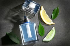 Composition with modern male perfume. On grey textured background Royalty Free Stock Image