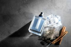 Composition with modern male perfume. On grey textured background Royalty Free Stock Images