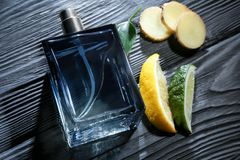 Composition with modern male perfume. On dark wooden background, closeup Stock Image