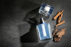 Composition with modern male perfume. On grey textured background Stock Photos