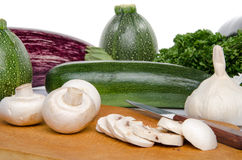 Composition with mushrooms, eggplants and zucchini Stock Photo