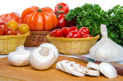 Composition with mushrooms, tomatoes, garlic and parsley Stock Images