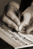 Composition of music. The hand writes musical notes a feather Stock Photo