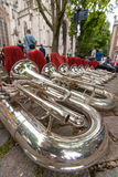 Composition of musical instruments on the ground in a row. Stock Photo