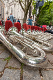 Composition of musical instruments on the ground in a row. Stock Photography