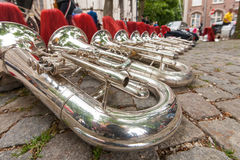 Composition of musical instruments on the ground in a row. Royalty Free Stock Images