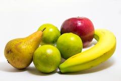 Composition naturelle en fruits, poire de banane de chaux de pomme Photos libres de droits