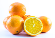 Composition of nicely colored oranges on a white background - front and back and cut in half.  Stock Images