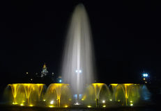 Composition from night fountains. One big and set of small fountains Stock Photos