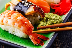 The composition of nigiri sushi with  shrimp, eel, salmon, butte Royalty Free Stock Photos