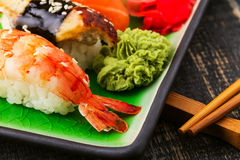 The composition of nigiri sushi with  shrimp, eel, salmon, butterfish on rice Stock Photography