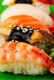 The composition of nigiri sushi with  shrimp, eel, salmon, butterfish on rice Stock Images