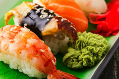 The composition of nigiri sushi with  shrimp, eel, salmon, butterfish on rice Stock Photos