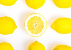 Composition with nine Lemons, one of them cut in half,  photo  Flat Lay Style Royalty Free Stock Photos