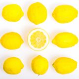 Composition with nine Lemons, one of them cut in half,  photo  Flat Lay Style Stock Image