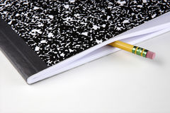 Composition notebook and pencil royalty free stock photos