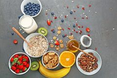 Composition with nutritious oatmeal. And different ingredients for breakfast on grey background Royalty Free Stock Photography