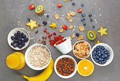Composition with nutritious oatmeal. And different ingredients for breakfast on grey background Royalty Free Stock Image