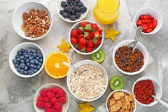 Composition with nutritious oatmeal. And different ingredients for breakfast on light background Royalty Free Stock Photos