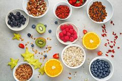 Composition with nutritious oatmeal. And different ingredients for breakfast on light background Royalty Free Stock Photo