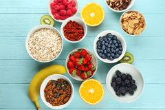 Composition with nutritious oatmeal. And different ingredients for breakfast on wooden background Royalty Free Stock Photography