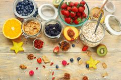 Composition with nutritious oatmeal. And different ingredients for breakfast on wooden background Stock Image