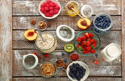 Composition with nutritious oatmeal. And different ingredients for breakfast on wooden background Royalty Free Stock Photos