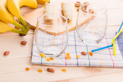 Composition of nuts and bananas on wood. Royalty Free Stock Photo