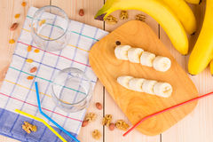 Composition of nuts and bananas on wood. Stock Photography