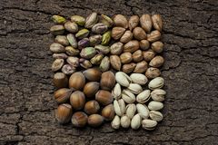 Composition with nuts, hazelnuts and pistachios close up Royalty Free Stock Images